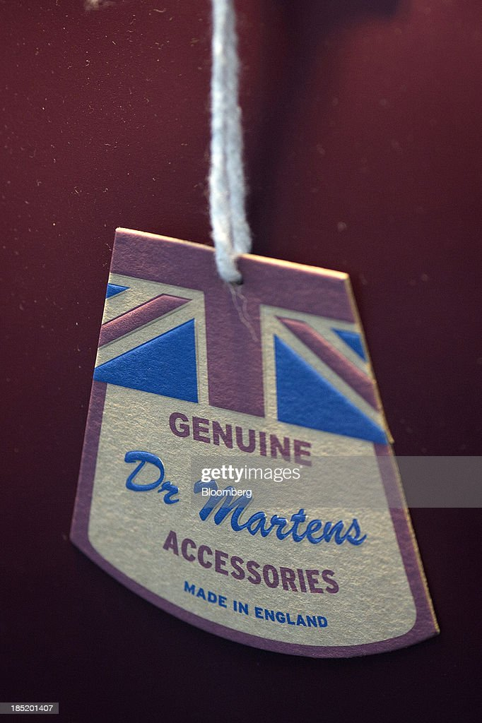 A British Union flag sits on a tag for a pair of Dr Martens boots inside a footwear store in London UK on Friday Oct 18 2013 Permira Advisers LLP the...