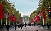 British Union flags and Chinese flags fly together on the Mall in central London on October 18 2015 Chinese President Xi Jinping begins a fourday...
