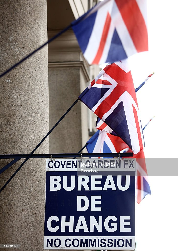 British Union flags, commonly known as a Union Jack, hang above the entrance to a foreign currency exchange bureau in London, U.K., on Tuesday, June 28, 2016. The pound rose for the first time since the U.K.s vote to leave the European Union, as a recovery in investor appetite for higher-yielding assets seeped through currency markets. Photographer: Chris Ratcliffe/Bloomberg via Getty Images