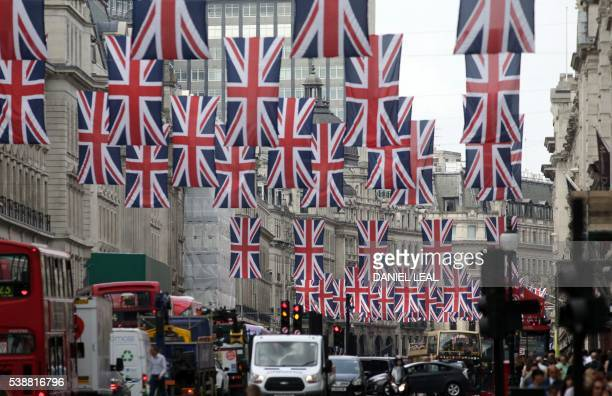 British Union flags hang above Regent Street in central London on June 8 as Britain prepares to celebrate the 90th birthday of Queen Elizabeth II...