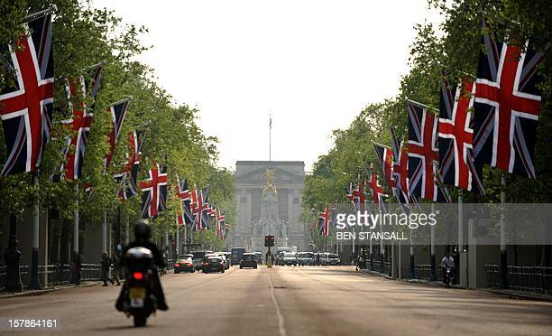 British Union Jack flags fly on the Mall leading to Buckingham Palace on April 26 ahead of the royal wedding between Britain's Prince William and...