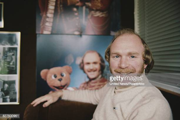 British ventriloquist Roger De Courcey pictured with a photograph of himself and Nookie Bear in London on 31st January 1978