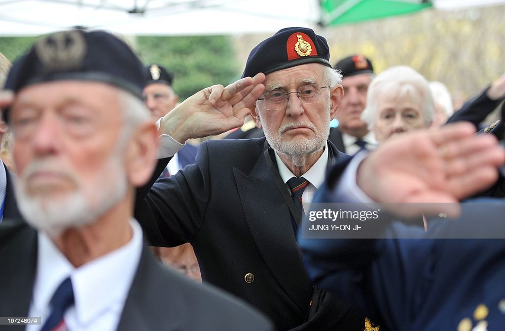 British veterans who fought alongside South Korea during the 1950-53 Korean War, salute during a ceremony to commemorate the 62nd anniversary of the action of British 29 Brigade at the battle of the Imjin River, at Gloster Valley in Paju, north of Seoul, 23 April 2013. The veterans laid the wreath at a British monument on Gloster Valley to remember some 800 British men killed in the fierce battle on 22-25 April 1951.