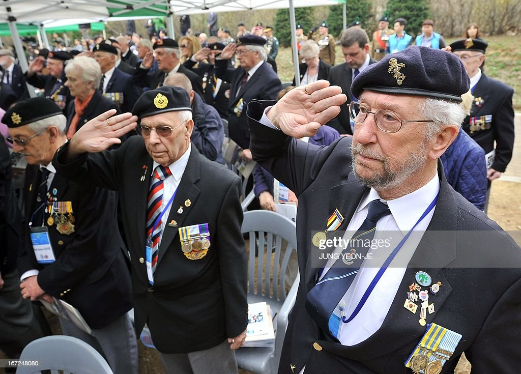 British veterans who fought alongside South Korea during the 1950-53 Korean War, salute during a ceremony to commemorate the 62nd anniversary of the action of British 29 Brigade at the battle of the Imjin River, at Gloster Valley in Paju, north of Seoul, 23 April 2013. The veterans laid the wreath at a British monument on Gloster Valley to remember some 800 British men killed in the fierce battle on 22-25 April 1951. AFP PHOTO / JUNG YEON-JE