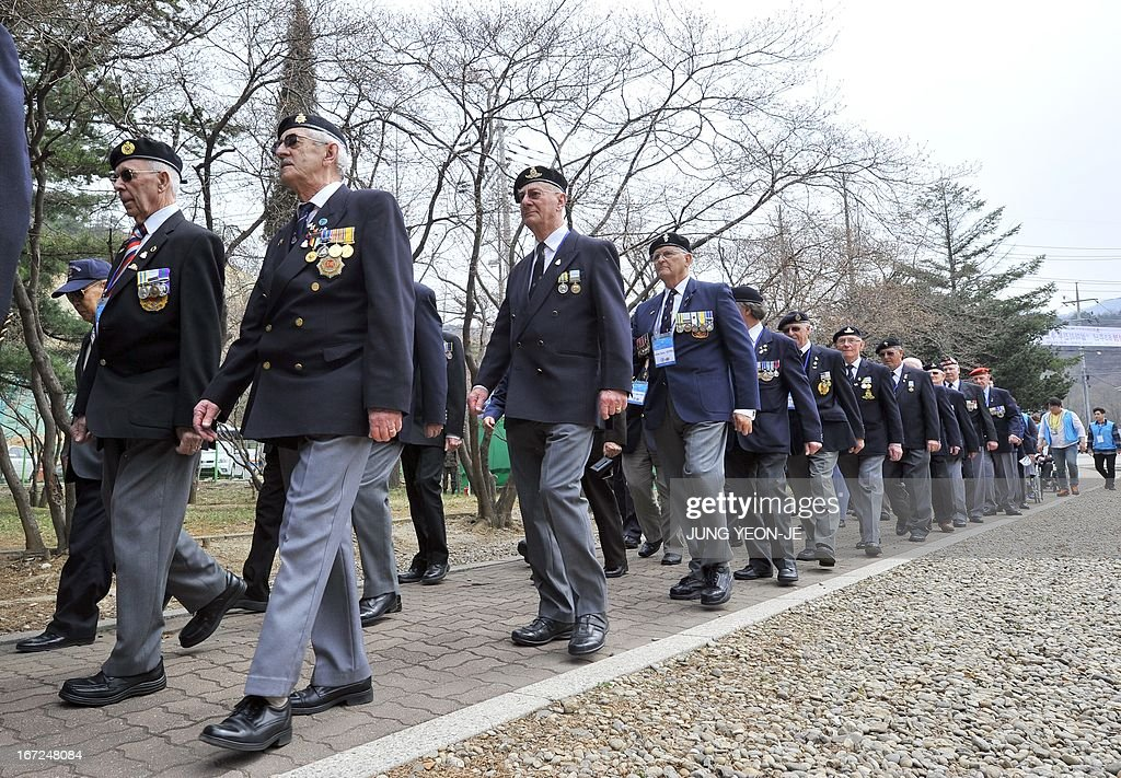 British veterans who fought alongside South Korea during the 1950-53 Korean War, march during a ceremony to commemorate the 62nd anniversary of the action of British 29 Brigade at the battle of the Imjin River, at Gloster Valley in Paju, north of Seoul, 23 April 2013. The veterans laid the wreath at a British monument on Gloster Valley to remember some 800 British men killed in the fierce battle on 22-25 April 1951. AFP PHOTO / JUNG YEON-JE