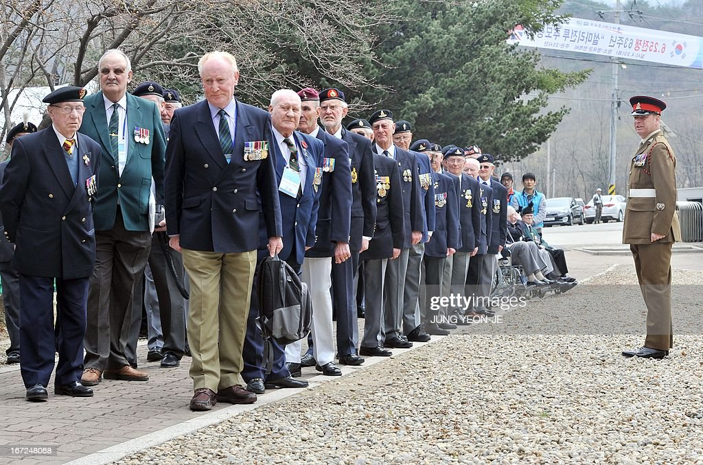 British veterans who fought alongside South Korea during the 1950-53 Korean War, stand in rows during a ceremony to commemorate the 62nd anniversary of the action of British 29 Brigade at the battle of the Imjin River, at Gloster Valley in Paju, north of Seoul, 23 April 2013. The veterans laid a wreath at a British monument on Gloster Valley to remember some 800 British men killed in the fierce battle on 22-25 April 1951. AFP PHOTO / JUNG YEON-JE