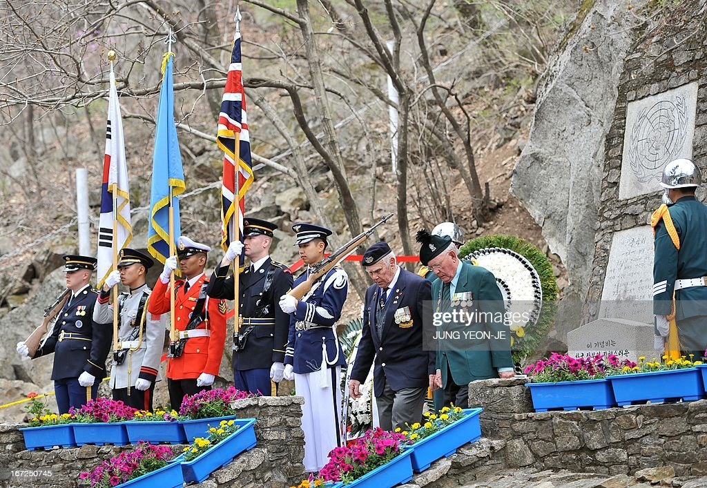 British veterans (C), who fought alongside South Korea during the 1950-53 Korean War, passes by UN Command honour guards (L) during a ceremony to commemorate the 62nd anniversary of the action of British 29 Brigade at the battle of the Imjin River, at Gloster Valley in Paju, north of Seoul, 23 April 2013. The veterans laid the wreath at a British monument on Gloster Valley to remember some 800 British men killed in the fierce battle on 22-25 April 1951.