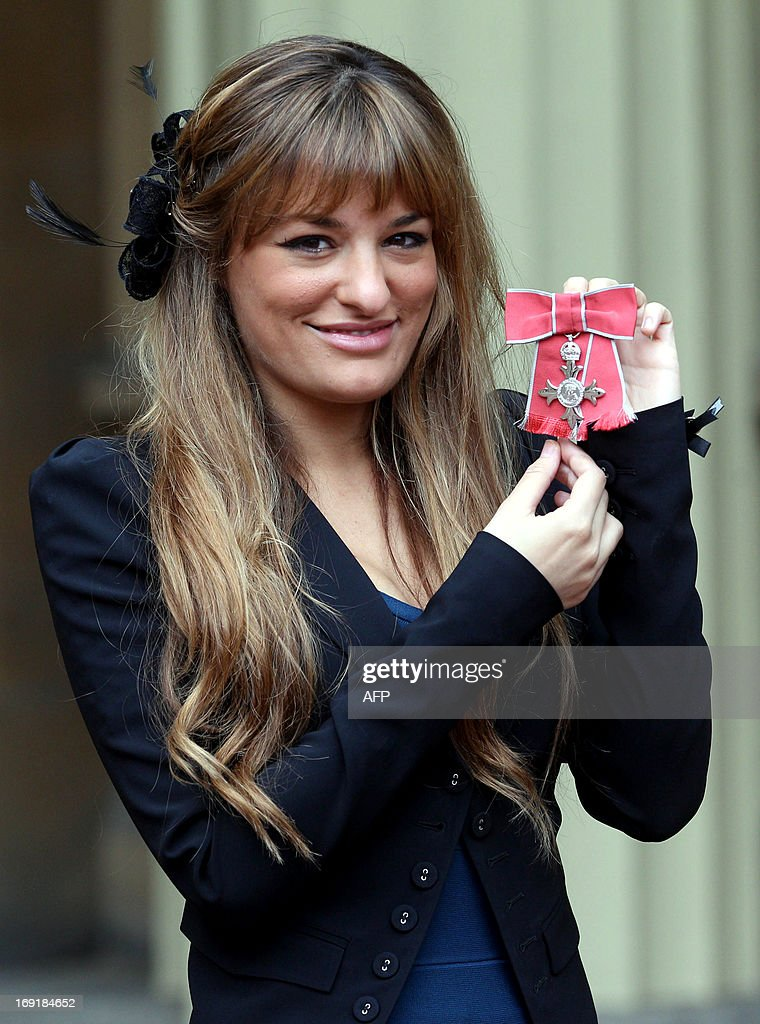 British violinist Nicola Benedetti poses for a picture with her Member of The British Empire (MBE) that she was awarded during the investiture ceremony at Buckingham Palace in London on May 21, 2013.