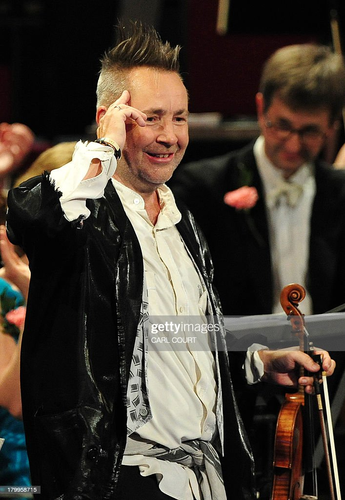 British violinist Nigel Kennedy gestures to the audience as he performs at the Royal Albert Hall in west London on September 7, 2013 during the Last Night of the Proms. US conductor Marin Alsop became the first woman to conduct the Last Night of the Proms in its 118-year history.