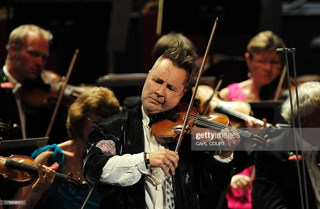 British violinist Nigel Kennedy performs at the Royal Albert Hall in west London on September 7, 2013 during the Last Night of the Proms. US conductor Marin Alsop became the first woman to conduct the Last Night of the Proms in its 118-year history.