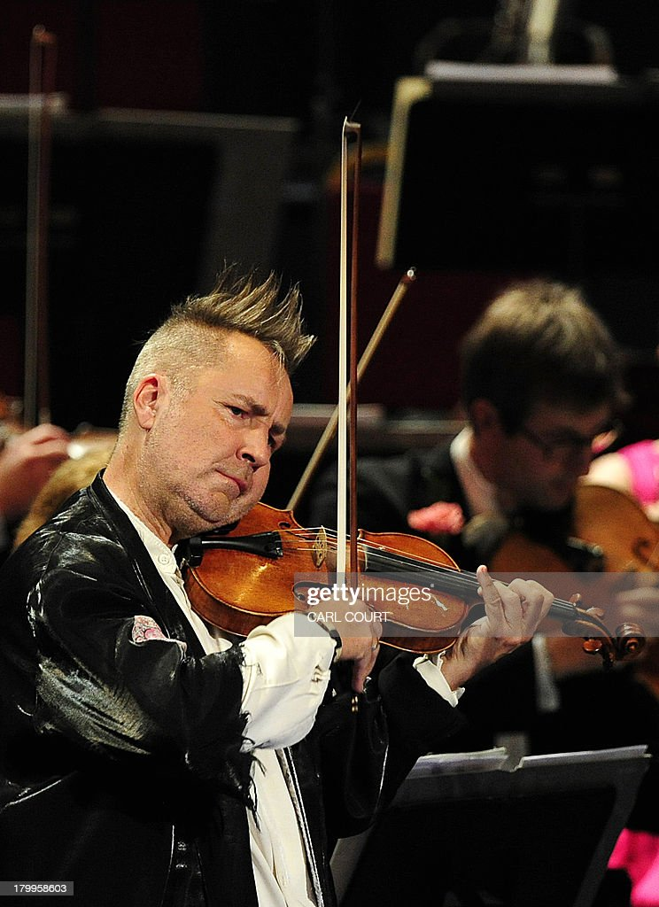 British violinist Nigel Kennedy performs at the Royal Albert Hall in west London on September 7, 2013 during the Last Night of the Proms. US conductor Marin Alsop became the first woman to conduct the Last Night of the Proms in its 118-year history. AFP PHOTO/CARL COURT
