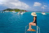 British Virgin Islands, Marina Key, woman sitting at bow of sailboat