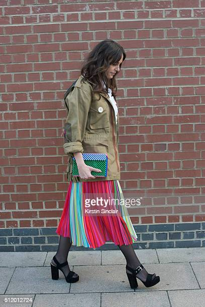 British Vogue contributing editor Tania Fares wears a Mary Katrantzou skirt Natasha Zinko jacket Topshop shirt and Gianvito Rossi shoes on day 5...