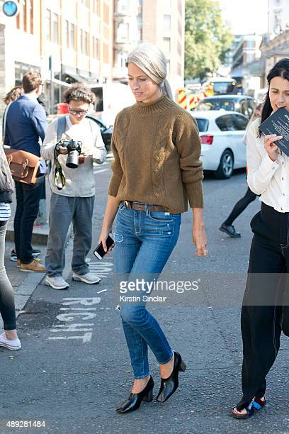 British Vogue Fashion features Editor Sarah Harris wears Margaret Howell sweater Paige jeans and Louis Vuitton bel on day 2 during London Fashion...
