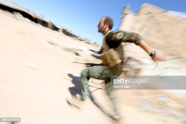 British volunteer fighter 'Macer Gifford' runs for cover on August 19 2017 in Raqqa Five years ago 'Macer Gifford' was working in London for The...