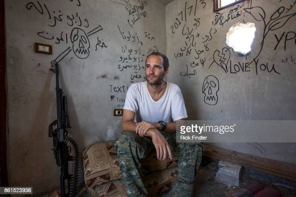 British volunteer fighter 'Macer Gifford' sits in one of his locations which he uses to fire his sniper rifle targeting ISIS on August 18 2017 in...