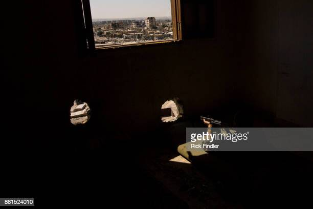 British volunteer fighter 'Macer Gifford' takes up his sniper position in a tower on the front lines on August 19 2017 in Raqqa Syria Five years ago...