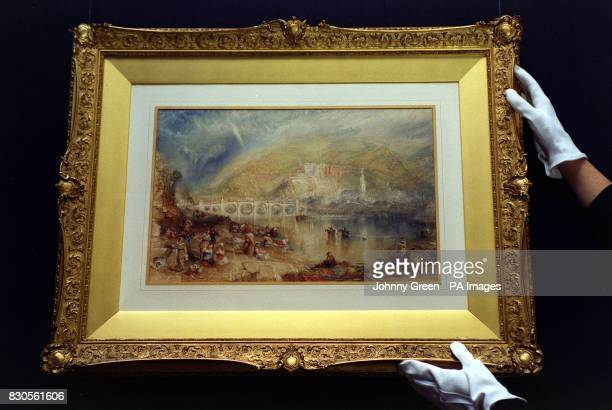British Watercolour specialist Amanda Stucklin and Sandie Maylor Sotheby's press officer with the painting by J M W Turner entitled View of...