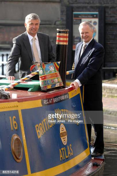 British Waterways Chief Executive Robin Evans and Chairman Tony Hales arrive for today's Annual General Meeting in Birmingham aboard a 1935 heritage...
