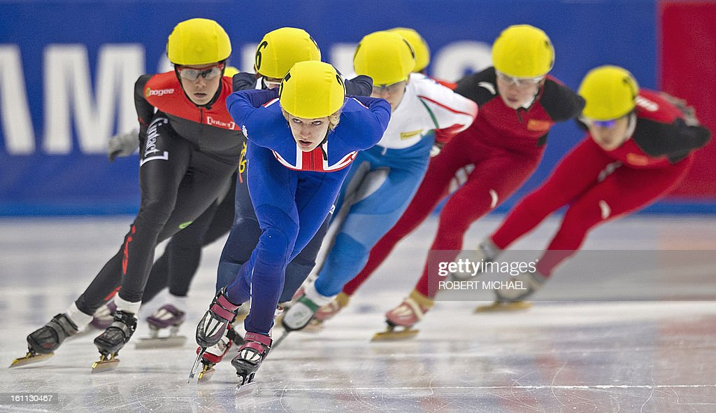 British winner Elise Christie leads the pack during the women's 1500 m a final race of the ISU World Cup short track speed skating event in Dresden, eastern Germany, on February 9, 2013. AFP PHOTO / ROBERT MICHAEL