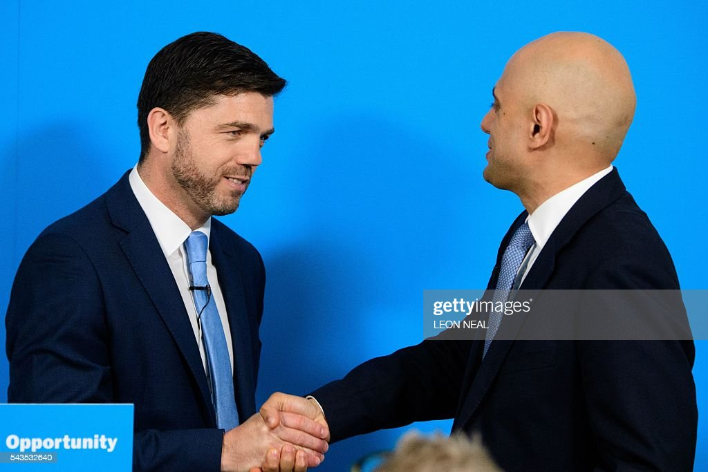 British Work and Pensions Secretary and Conservative MP, Stephen Crabb, (L) shakes hands with British Business Secretary Sajid Javid following a news conference in central London on June 29, 2016, where Crabb announced his candidacy for the leadership of the Conservative Party. British Prime Minister David Cameron's successor will be announced on September 9 after nominations are submitted by June 30 at the latest, the Conservative Party said. Britain has been pitched into uncertainty by the result of the June 23 referendum, with Cameron announcing his resignation, the economy facing a string of shocks and Scotland making a fresh threat to break away. / AFP / LEON