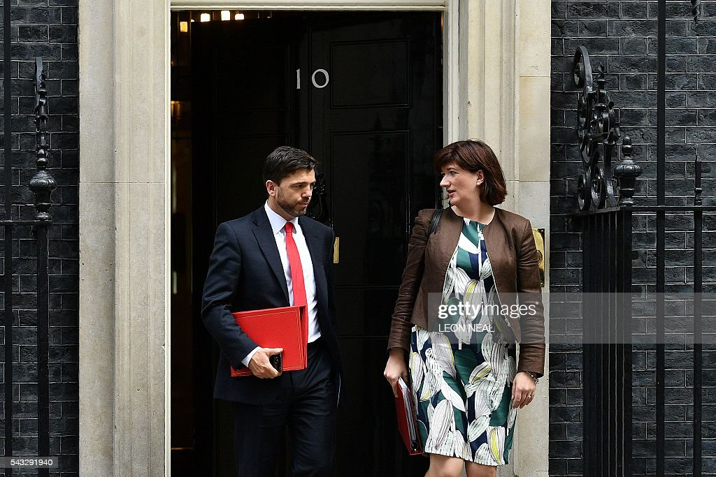 British Work and Pensions Secretary Stephen Crabb (L) and British Education Secretary and Minister for Women and Equalities Nicky Morgan walk through the door of 10 Downing Street after attending a cabinet meeting in central London on June 27, 2016. European stock markets mostly slid Monday as British finance minister George Osborne attempted to calm jitters after last week's shock Brexit referendum. Britain's surprise referendum decision to leave the European Union wiped $2.1 trillion off market valuations on Friday and sent the pound collapsing to a 31-year low against the dollar. / AFP / LEON