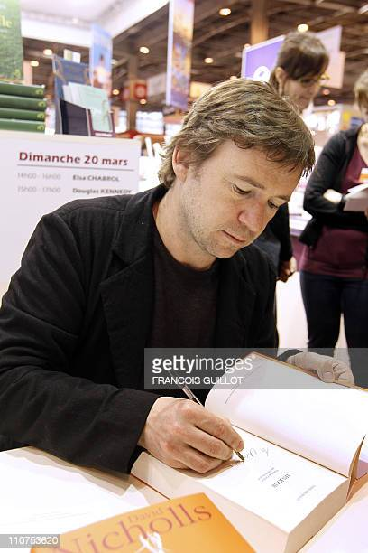 British writer David Nicholls signs his book during the 31st Paris' book fair on March 19 2011 in Paris Paris' 2011 book fair focuses on Nordic...
