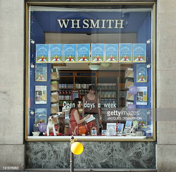 British writer Isabel Losada signs her book to a client at the WHSmith bookstore on March 15 2012 in Paris during the launch of her new book 'Mes...