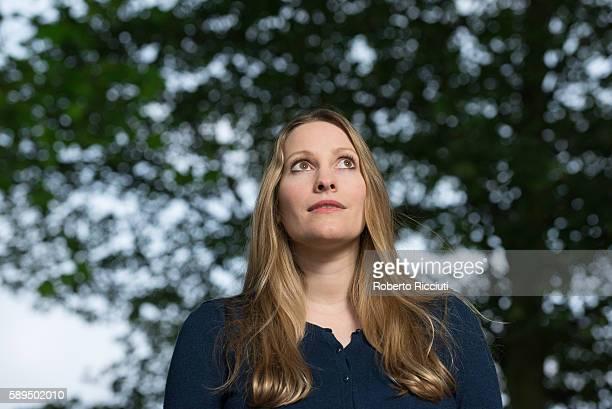 British writer Laura Bates attends a photocall at Edinburgh International Book Festival at Charlotte Square Gardens on August 14 2016 in Edinburgh...