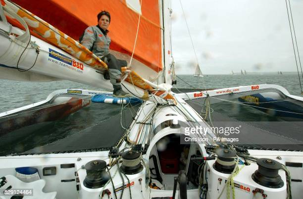 British yachtswoman Ellen MacArthur sits on the mast boom as the auto helm aboard her 75 foot triamaran Castorama BQ guides her through the Solent...