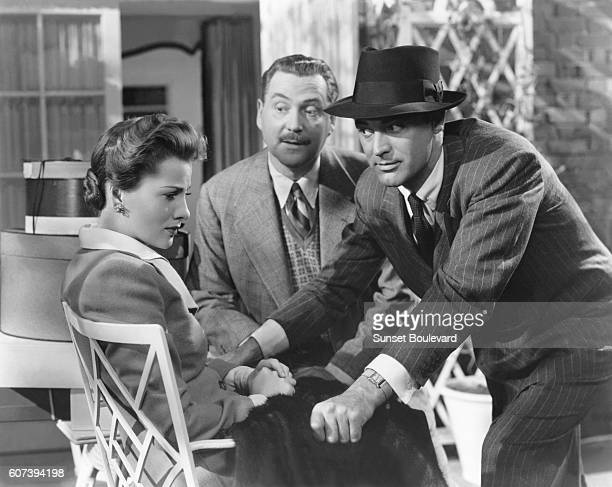 BritishAmerican actors Joan Fontaine Nigel Bruce and Cary Grant on the set of Suspicion directed and produced by Alfred Hitchcock
