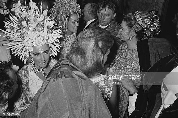 BritishAmerican actress Elizabeth Taylor and Welsh actor Richard Burton attend a masked ball at the Rezzonico Palace Venice 1967