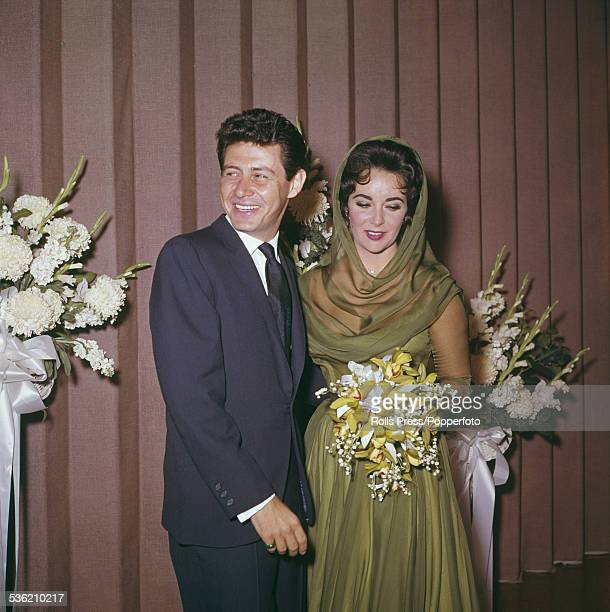 BritishAmerican actress Elizabeth Taylor pictured with her fourth husband singer and entertainer Eddie Fisher at their wedding ceremony in Las Vegas...