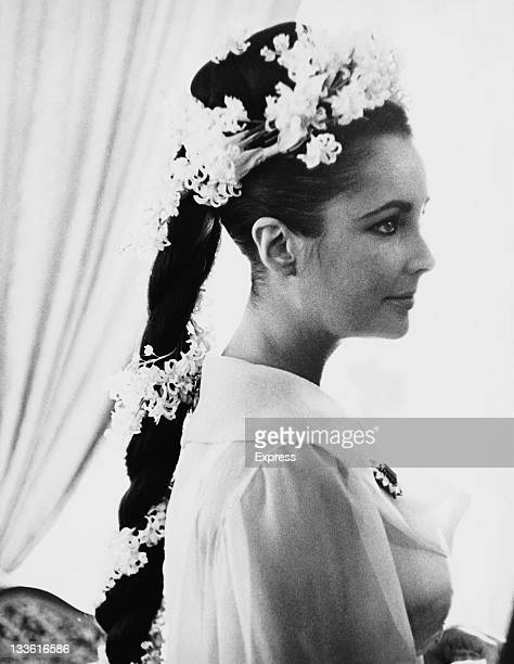 BritishAmerican actress Elizabeth Taylor wearing a plaited hair extension at her first wedding to Welsh actor Richard Burton Montreal Canada 15th...