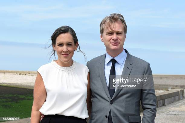 BritishAmerican film director Christopher Nolan poses with British film producer Emma Thomas on July 16 during a photocall in Dunkirk ahead of the...