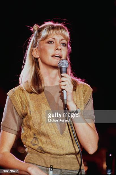 BritishAustralian singer and actress Olivia NewtonJohn performs in rehearsal for 'The Music for UNICEF Concert A Gift of Song' benefit concert held...