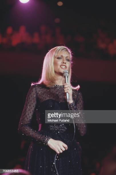 BritishAustralian singer and actress Olivia NewtonJohn performs on stage at 'The Music for UNICEF Concert A Gift of Song' benefit concert held at the...