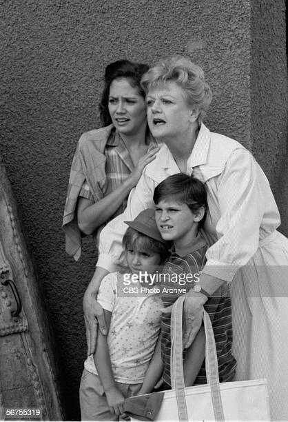 Britishborn actress Angela Lansbury protects American sibling child actors Summer Phoenix and River Phoenix and actress Anne Kerry in a scene from an...