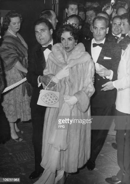 Britishborn actress Elizabeth Taylor and her husband producer Mike Todd after an inaugural screening of his film 'Around the World in Eighty Days' at...