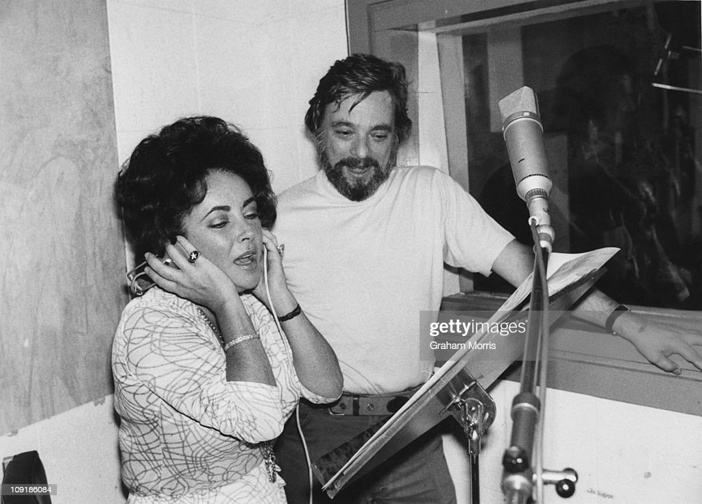 British-born actress Elizabeth Taylor at a Wembley studio with Stephen Sondheim, to record the songs for the film 'A Little Night Music', 10th August 1976. Sondheim wrote the music and lyrics for the film.
