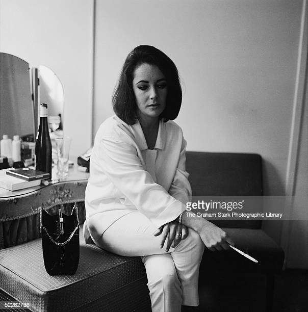 Britishborn actress Elizabeth Taylor during a visit to Richard Burton on the set of Peter Glenville's 'Becket' in which Burton plays the title role...