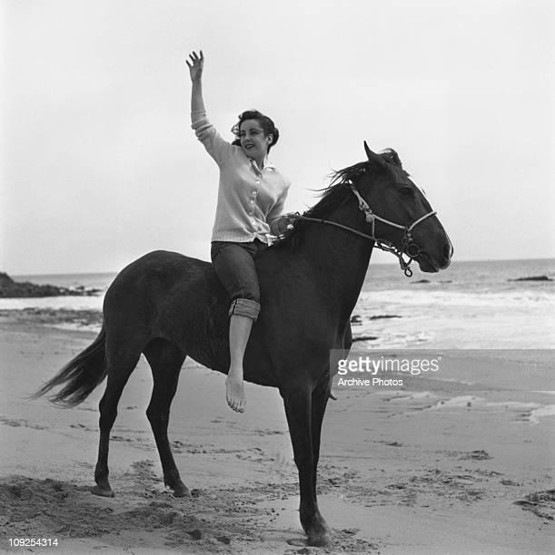 Britishborn actress Elizabeth Taylor on horseback on a beach circa 1949