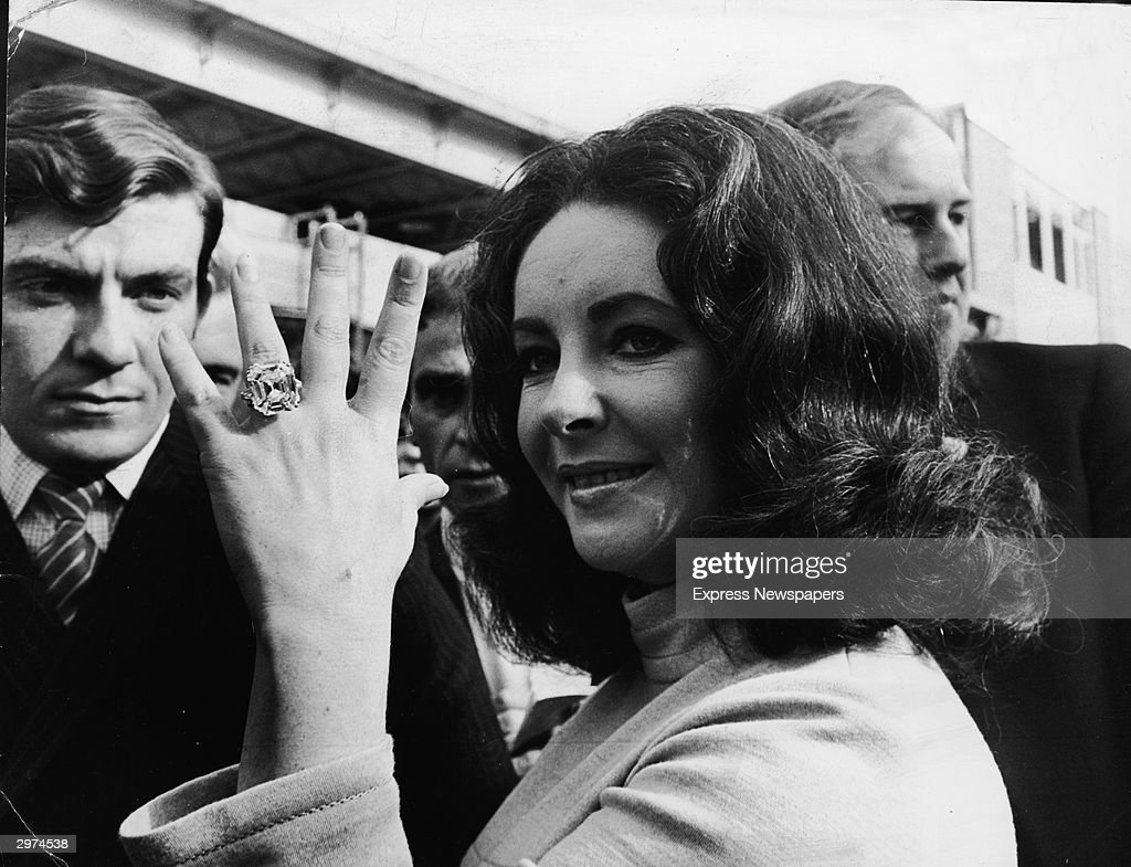 Britishborn actress Elizabeth Taylor shows off the 3319 carat diamond ring given to her by husband Richard Burton