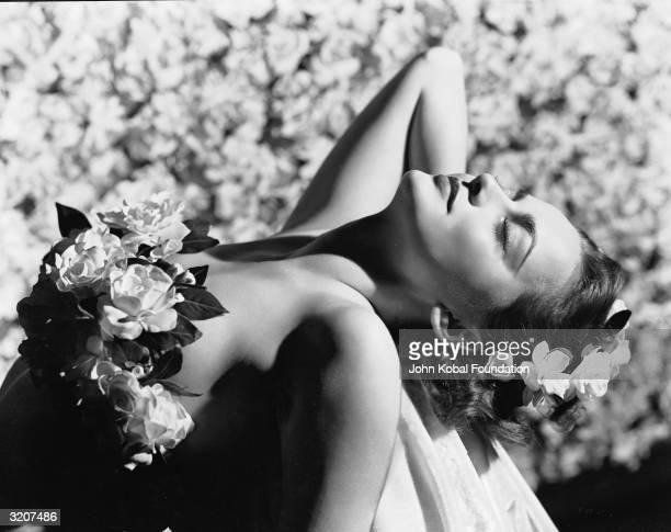 Britishborn actress Olivia de Havilland adorned with flowers