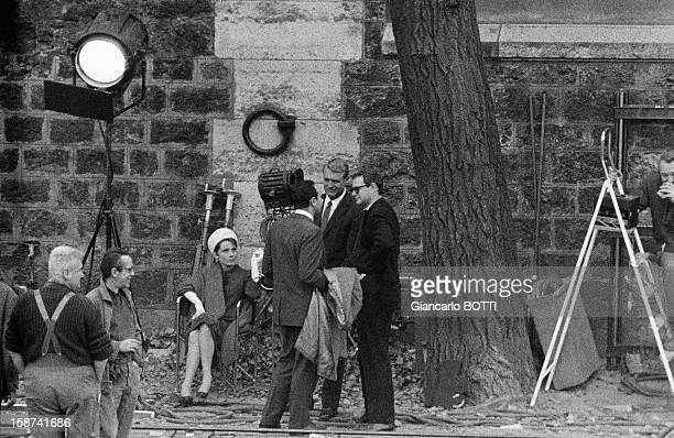 Britishborn American actor Cary Grant with female counterpart Audrey Hepburn on the set of thriller and romance film 'Charade' directed by Stanley...