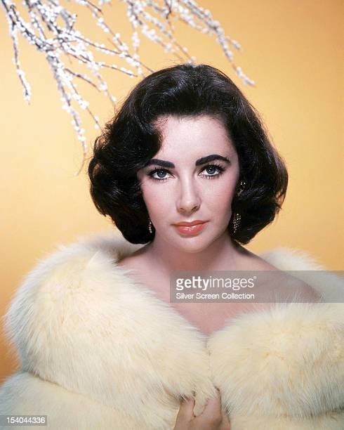 Britishborn American actress Elizabeth Taylor in a white fur coat circa 1955