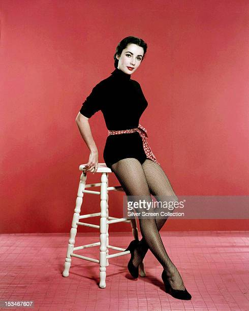 Britishborn American actress Elizabeth Taylor wearing a black leotard and fishnet stockings circa 1955