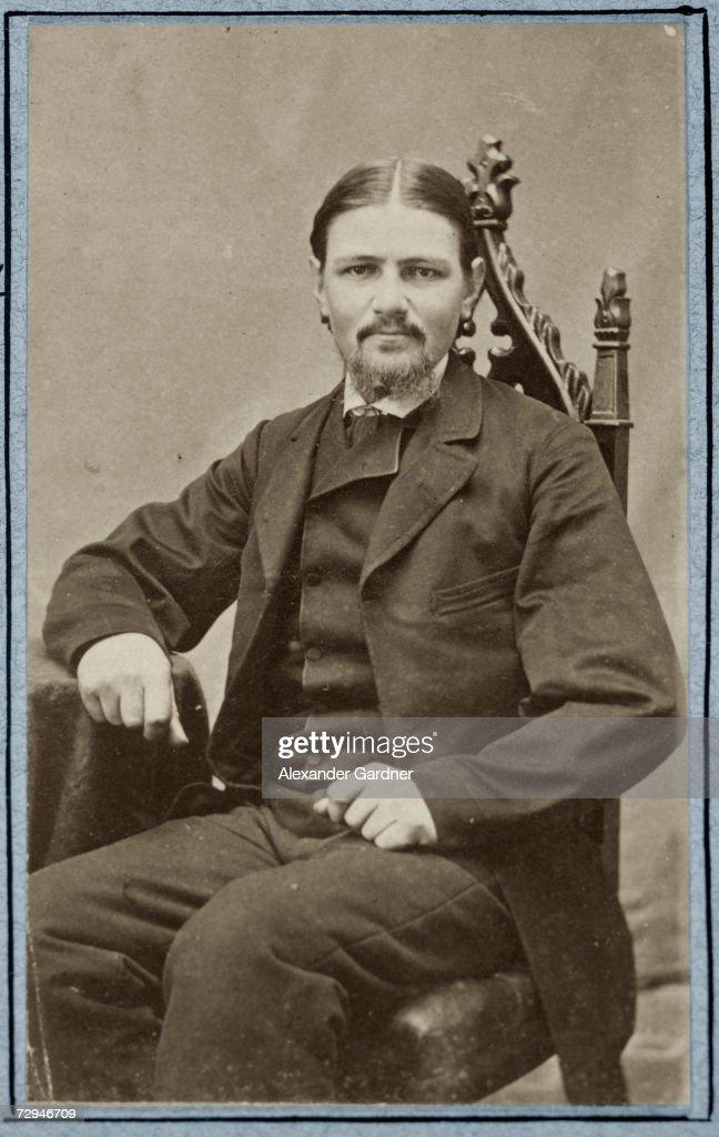 Britishborn American hatter and soldier Boston Corbett born Thomas Corbett poses sitting in a chair 1865 Corbett was a sergeant in the 16th New York...