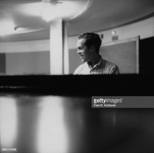 Britishborn composer and Fluxus artist Dick Higgins in a classroom at the New School New York New York August 5 1959 At the time Higgins was a...