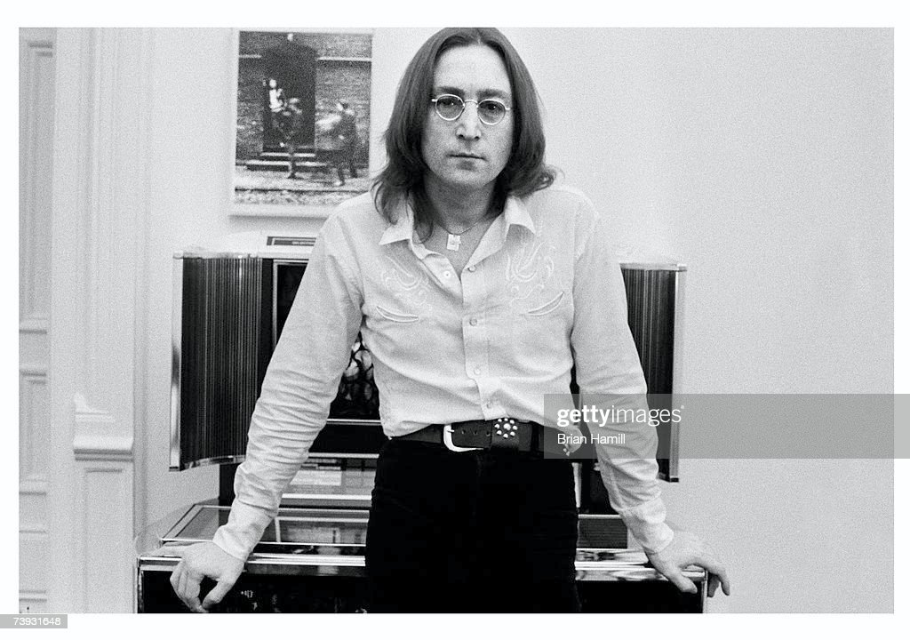 British-born singer and songwriter <a gi-track='captionPersonalityLinkClicked' href=/galleries/search?phrase=John+Lennon&family=editorial&specificpeople=91242 ng-click='$event.stopPropagation()'>John Lennon</a> (1940 - 1980), formerly of the Beatles, wears a Western shirt and belt, as he leans against a jukebox in his apartment at the Dakota, New York, New York, February 25, 1975.